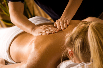 Giving Swedish Back Massage to blond woman