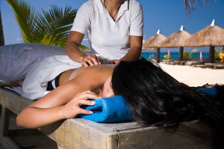 A relaxing massage on the beach of a tropical paradise