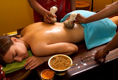 indian doctors doing traditional ayurvedic oil Herbal back massage
