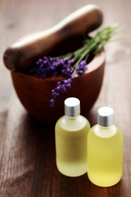 bottle of lavender massage oil for aromatherapy massage