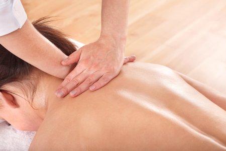 Applying myofascial release technique to neck area