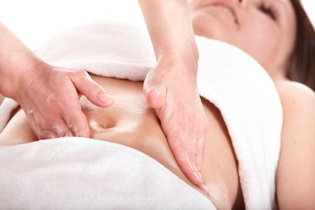 two hands abdomen vibration massage on woman