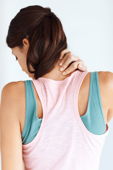 Young girl having neck pain
