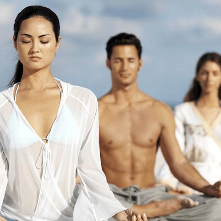 Man and women practicing meditation