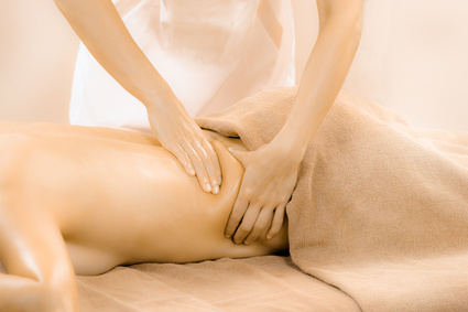 Woman receiving massage for low back pain